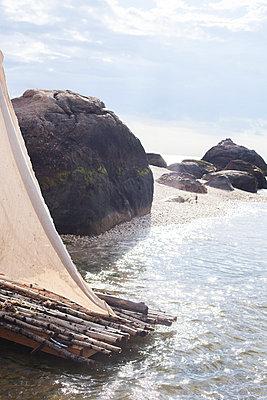 Raft on beach - p956m892318 by Anna Quinn