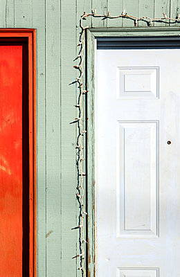 Colorful Doorways With Holiday Lights - p1100m2090847 by Mint Images