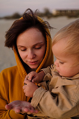 Woman and her son on beach - p1363m2142786 by Valery Skurydin