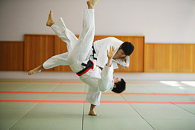 Two Men Competing in a Judo Match - p3070553f by Score. by Aflo