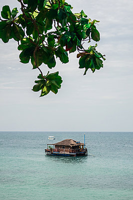 Raft with house on the ocean - p930m1541622 by Ignatio Bravo