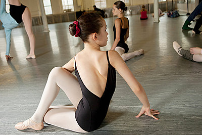 Girl doing exercise in ballet class - p9245501f by Image Source