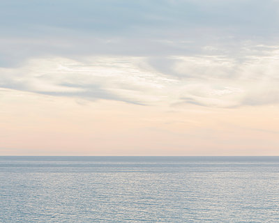 The ocean, view to the horizon with a gathering dusk.  - p1100m1451078 by Mint Images