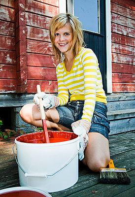 Girl stiring paint - p4265606f by Tuomas Marttila