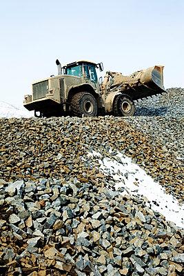 Digger on mine dump - p902m955680 by Mölleken