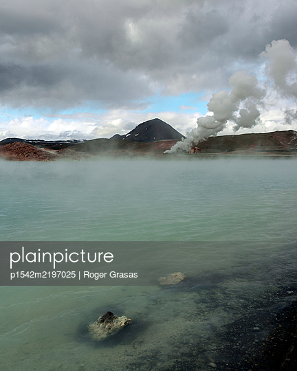 Lake and geyser in Iceland - p1542m2197025 by Roger Grasas