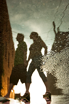 reflection of a couple walking - p1296m1467344 by Jean-François Brière