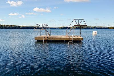 Wooden pontoon on lake - p1242m1194739 by teijo kurkinen