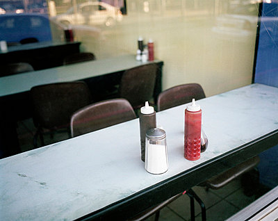 Condiments in cafe window - p3882860 by Jim Green