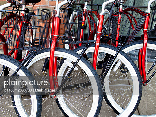 Identical Red Bikes - p1100m2090793 by Mint Images