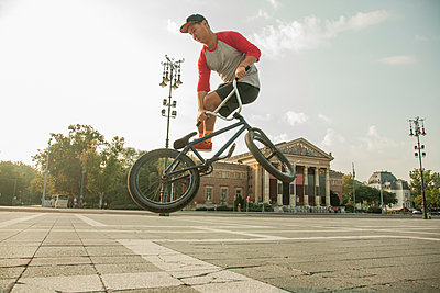 BMX cyclist doing stunt, Heroes' Square (Hosök Tere), Budapest, Hungary - p429m2050784 by Seb Oliver