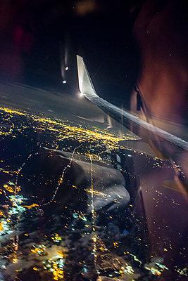 Airplaine approaching John F. Kennedy International Airport at night - p1057m1466824 by Stephen Shepherd