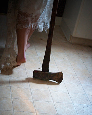 A ax and a woman's legs. - p343m1554626 by Ron Koeberer