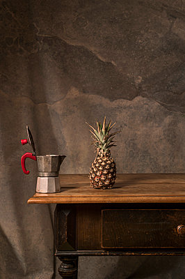 Espresso pot and pineapple on sideboard - p947m2178579 by Cristopher Civitillo