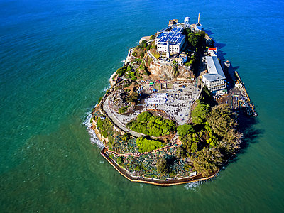Aerial view of the prison island of Alcatraz in San Francisco Bay. - p1100m1216204 by Mint Images