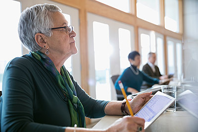 Attentive senior woman using digital tablet in classroom - p1192m1212928 by Hero Images