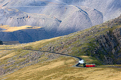 Steam train on route between Llanberis and the summit of Mount Snowdon in Snowdonia National Park, Gwynedd, Wales, United Kingdom, Europe - p871m1049910 by Graham Lawrence