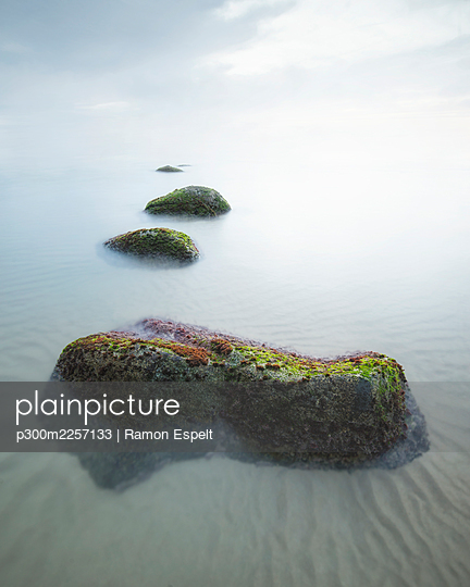 Rock formations in sea against sky - p300m2257133 by Ramon Espelt