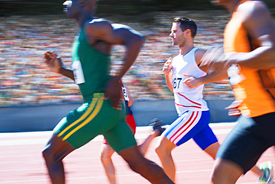 Runners racing on track - p1023m923621f by Paul Bradbury