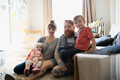 Portrait young family relaxing in living room - p1192m1158211 by Hero Images