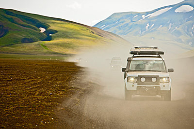 SUV driving through dusty landscape on the Icelandic highlands;  Domadalur;  Fjallabak;  Iceland - p429m860224f by Henn Photography