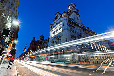 Light trails by building in Liverpool, England - p1427m2038291 by Henryk Sadura