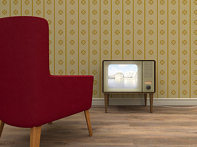 Old television and red armchair in a retro styled living room - p300m978838f by UWE