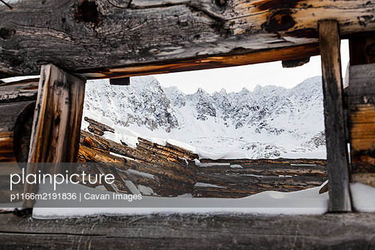 Jagged mountains and log cabin ruin in Mayflower Gulch, Colorado - p1166m2191836 by Cavan Images