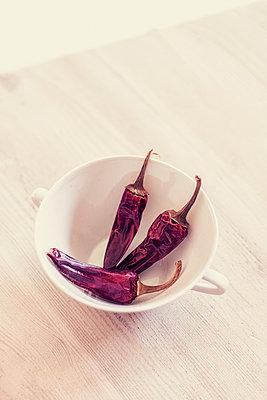 Three chili peppers - p879m2273308 by nico