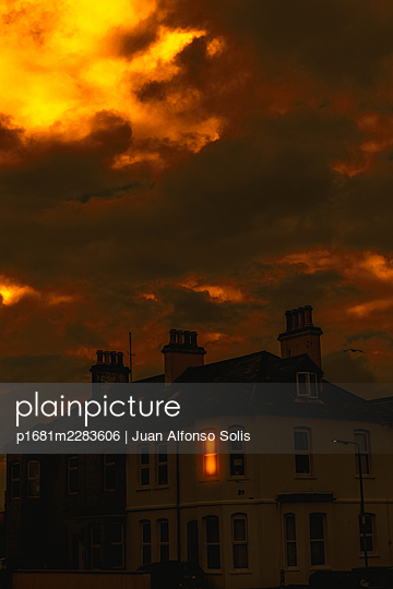 Thunderclouds over residential building, Newcastle, Northern Ireland - p1681m2283606 by Juan Alfonso Solis
