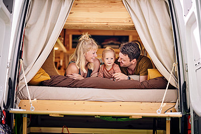 Family relaxing in motor home - p1124m2228985 by Willing-Holtz