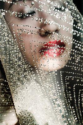 Beautiful Asian Woman Behind Glittering Transparent Veil   - p1417m2158378 by Jessica Lia