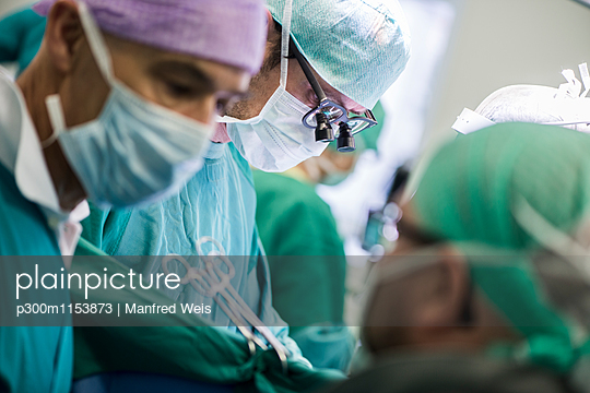 Surgeons in operating theatre - p300m1153873 by Manfred Weis