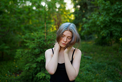 Exhausted woman at the edge of the woods - p1646m2264259 by Slava Chistyakov