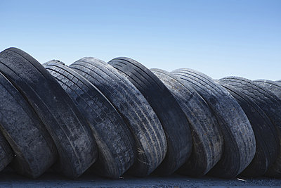 A row of discarded rubber tires.  - p1100m876466f by Paul Edmondson