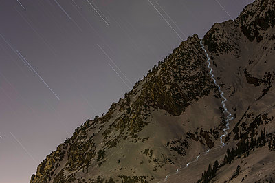 Snowboarder at Night - p343m1173349 by Ben Girardi