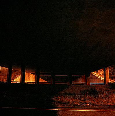 bridge on motorway at night - p3880020 by Bill Davies