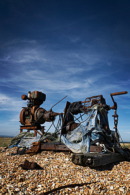Old rusted engine on shingle beach - p597m932726 by Tim Robinson