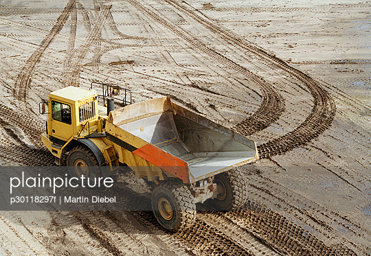 Dump truck on muddy ground