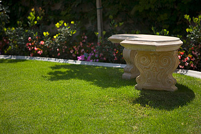 Stone Bench in Yard with Garden - p5550193f by LOOK Photography