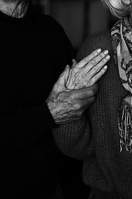 Wrinkled hands of old married couple - p1229m2175251 by noa-mar