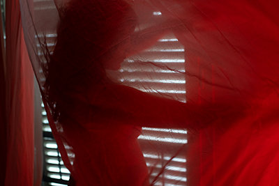 Woman behind a curtain - p1321m2210207 by Gordon Spooner
