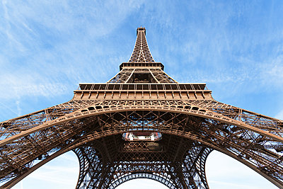 Low angle view of Eiffel Tower against sky - p1166m1230512 by Cavan Images