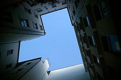 Gap in building revealing blue sky - p3881989 by L.B.Jeffries