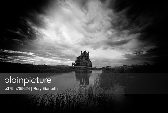 Abbey under storm clouds - p378m795624 by Rory Garforth