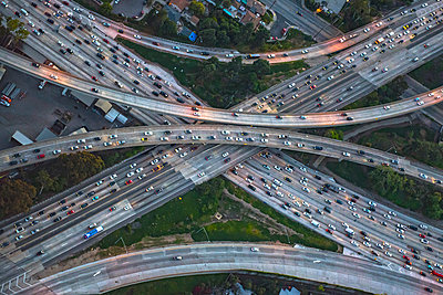 Aerial view of highway interchange in cityscape - p555m1305496 by Chris Sattlberger
