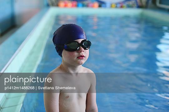 The boy learn to swim in the indoor pool - p1412m1488268 by Svetlana Shemeleva