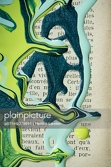 Paint on book page - p971m2278891 by Reilika Landen