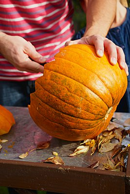 People carving Jack O'Lantern - p1026m906824f by AlexandraDost