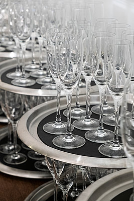 Rows of empty glasses on trays  - p1057m2037583 by Stephen Shepherd